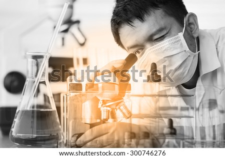 Chemist is analyzing sample in laboratory room - stock photo