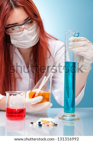 Chemist woman with test tubes