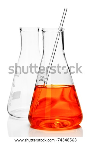 Chemistry conical flask with orange liquid - stock photo