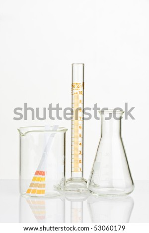 Chemistry Lab containers and PH indicator composition - stock photo