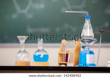 Chemistry laboratory glassware with liquid formula at the laboratory - stock photo