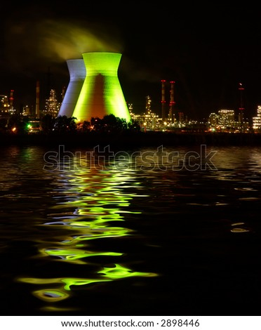 chemistry plant at night and water  reflection