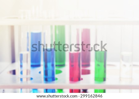 chemistry science test tube experiment blur background - stock photo