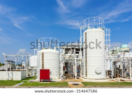 chemistry tank in factory with blue sky - stock photo
