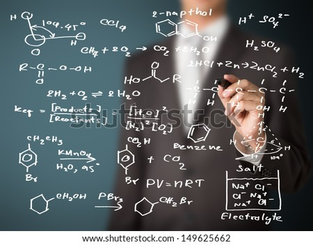 chemistry teacher writing science and chemical formula