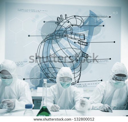 Chemists working with futuristic interface showing heart and DNA in blue - stock photo