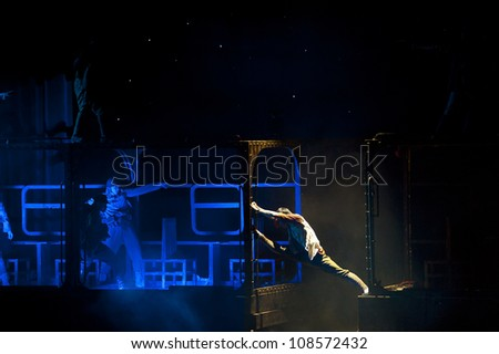 CHENGDU, CHINA - NOV 18: Chinese dancer performs modern dance drama onstage at JINCHENG theater on Nov 18, 2010 in Chengdu, China.