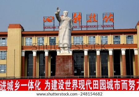 Chengdu, China - November 8, 2010:  A larger-than-life white statue of Chairman Mao Zedong with uplifted arm stands in front of the Sichuan Science and Technology Museum in Tianfu Square - stock photo