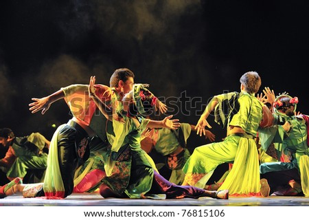 CHENGDU, CHINA - SEPT. 28: Chinese Qiang ethnic dancers perform on stage at Sichuan experimental theater on Sept. 28, 2010 in Chengdu, China. - stock photo