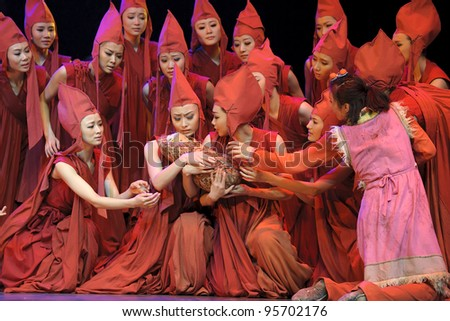 CHENGDU - MAY 25: Chinese Modern Dancers perform on stage at Xinan theater on May 25, 2011 in Chengdu, China.