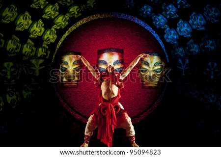 CHENGDU - OCT 18: Chinese national dancer performs folk dance on stage at JINCHENG theater on Oct 18, 2011 in Chengdu, China.