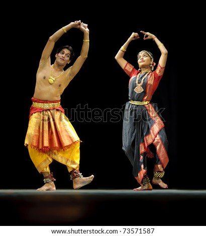 CHENGDU - OCT 24: Indian dancers perform folk dance onstage at JINCHENG theater during the festival of India in china on Oct 24, 2010 in Chengdu, China.