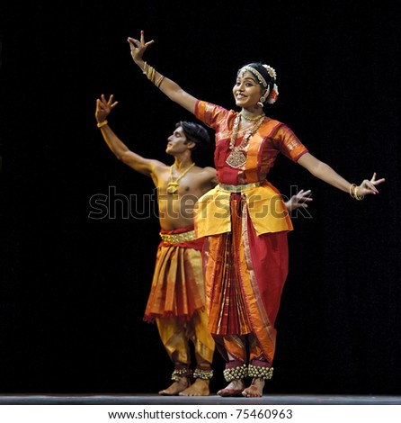CHENGDU - OCT 24: Indian dancing girl performs folk dance onstage at JINCHENG theater during the festival of India in china on Oct 24,2010 in Chengdu, China. - stock photo