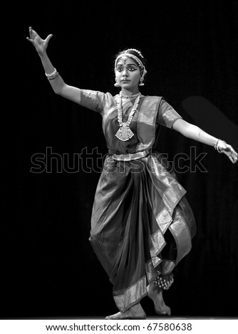 """CHENGDU - OCT 24: Indian folk dance """"Shankara Sri Giri"""" performed by Kalakshetra dance institute of India at JINCHENG theater during the festival of India in china OCT 24, 2010 in Chengdu, China. - stock photo"""