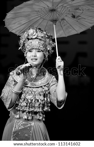 CHENGDU - SEP 28: chinese Miao ethnic singer performs on stage in the 6th Sichuan minority nationality culture festival at JINJIANG theater.Sep 28,2010 in Chengdu, China.