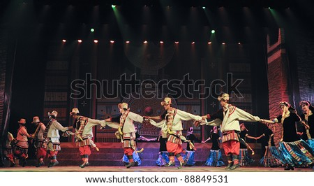 CHENGDU - SEP 27: chinese Tibetan ethnic dancers perform on stage at Sichuan experimental theater.Sep 27,2010 in Chengdu, China.