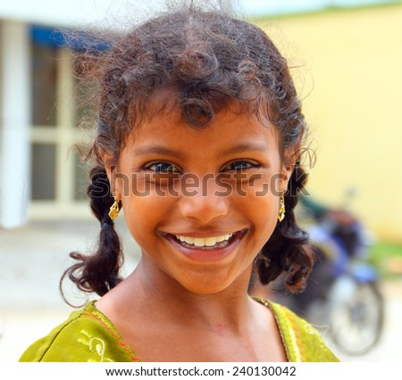 CHENNAI, INDIA - AUG 16: Unidentified hindu girl poses for a camera on August 16, 2014 in Chennai, Tamil Nadu, Southern India. Local people very like to take a picture with a foreigners. - stock photo