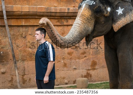 CHENNAI, INDIA-FEBRUARY 14: Blessing from elephant of India on February 14, 2013 in Chennai, India. Indian ritual blessing of the bishop. - stock photo