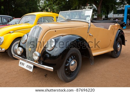 "CHENNAI - INDIA - JULY 24: Morris Series ""E"" Tourer 1946 retro vintage car on display at the Heritage Car Rally 2011 by the Madras Heritage Motoring Club at Egmore on July 24, 2011 in Chennai, India - stock photo"