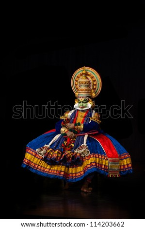Chennai - SEPTEMBER 15: Kathakali performer in the virtuous pachcha (green) role in Chennai on September 15, 2012 in South India. Kathakali is the ancient classical dance form of Kerala. - stock photo