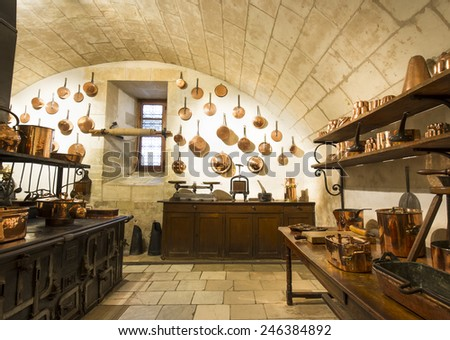 CHENONCEAUX, FRANCE - SEPTEMBER 24, 2011: Castle of Chenonceaux built in 1513 it is located on the Loire Valley of France. Photo of one of the fabulous kitchens constructed in the piers of the bridge  - stock photo