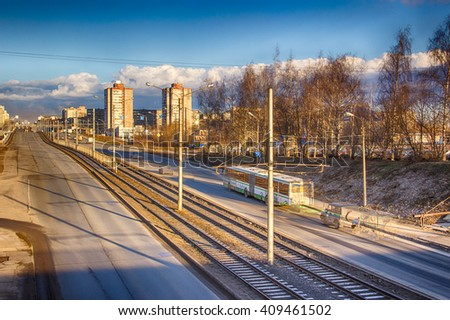 Cherepovets, Russia - April 11, 2016: Cars driving on the road, traffic in the spring morning. Typical cityscape with HDR technology