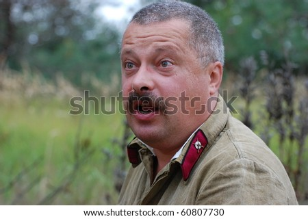 CHERNIGOW, UKRAINE - AUG 29: A member of Red Star military history club wears historical Soviet uniform during historical reenactment of WWII, August 29, 2010 in Chernigow, Ukraine