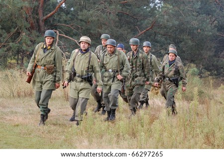 CHERNIGOW, UKRAINE - AUG 29: Members of Red Star military history club wear historical German paratrooper uniform during historical reenactment of WWII, August 29, 2010 in Chernigow, Ukraine