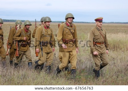 CHERNIGOW, UKRAINE - AUG 29: Members of Red Star military history club wear historical Soviet uniform during historical reenactment of WWII, August 29, 2010 in Chernigow, Ukraine