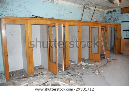 Chernobyl area. Lost city Pripyat. Modern ruins. Post-office. Phone-boxes.Ukraine. Kiev region.