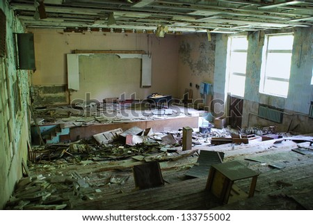 Chernobyl disaster results. This is assembly hall of the abandoned school in small city Pripyat (near Chernobyl nuclear station). Modern ruins. Ukraine. Kiev region
