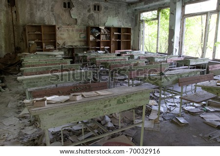 Chernobyl disaster results. This is classroom in abandoned school in small city Pripyat (about 5 kilometers form the Chernobyl nuclear station). - stock photo
