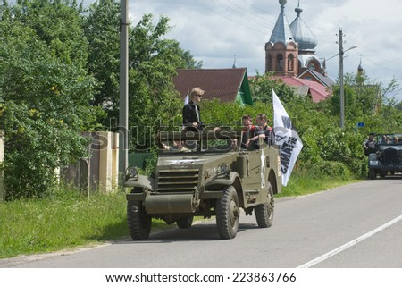 "CHERNOGOLOVKA, MOSCOW REGION, RUSSIA - JUNE 21, 2013:  American armored personnel carrier M3 Scout Car on the road, the 3rd international forum ""Motors of war"" near the city Chernogolovka"