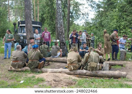 "CHERNOGOLOVKA, MOSCOW REGION, RUSSIA - JUNE 21, 2013: Camp in the woods, 3rd international meeting ""Motors of war"" near the city Chernogolovka, Moscow region"