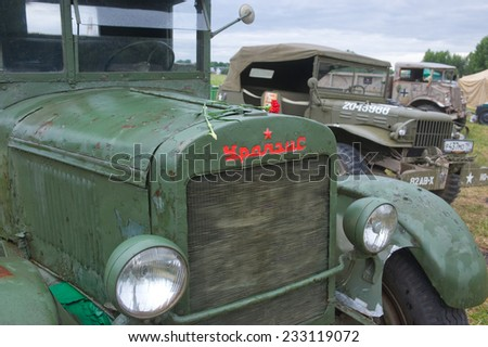 "CHERNOGOLOVKA, MOSCOW REGION, RUSSIA - JUNE 21, 2013: Soviet old truck Uralzis at the 3rd international meeting of ""Motors of war"" ,  close up front"