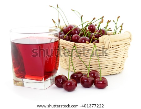 Cherries and a glass of cherry juice isolated on white - stock photo