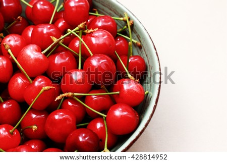 cherries in a bowl. various views of red bing cherries in a bowl. Ripe cherry in a vintage bowl. Fresh cherries in bowl on table - stock photo