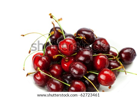 Cherries in a saucer isolated on white