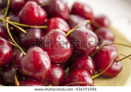 Cherries on the plate with water drops - macro background - stock photo
