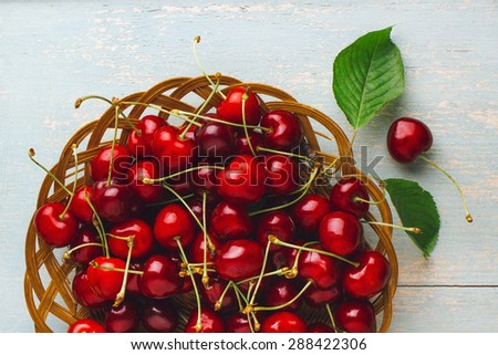 Cherries on wooden table
