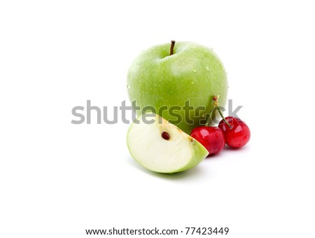 Cherries with a Granny Smith apple isolated on white - stock photo