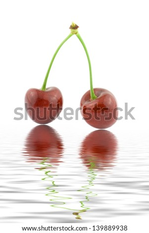 cherries with reflection in water