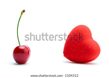 Cherry and a heart against white background - stock photo