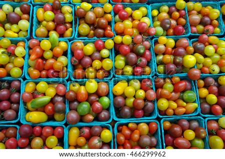 Cherry and heirloom tomatoes in containers close-up pattern