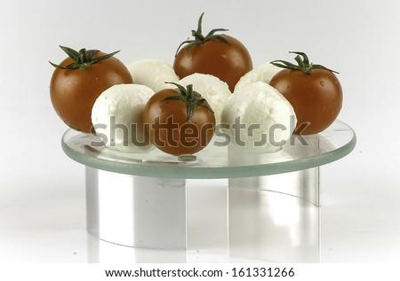 cherry baby tomato with mozzarella cheese balls on white - stock photo