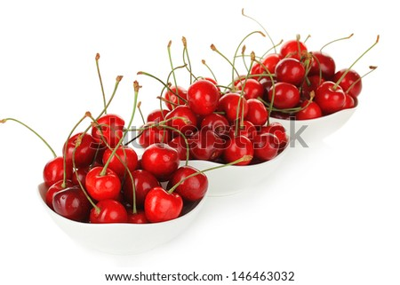Cherry berries in bowl isolated on white