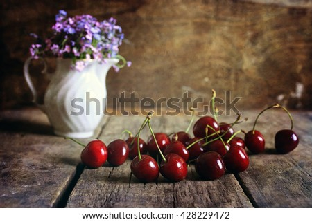cherry berry on wooden background retro - stock photo