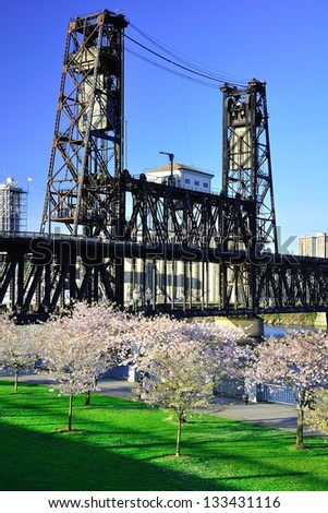 Cherry Blossoms and Steel Bridge - stock photo