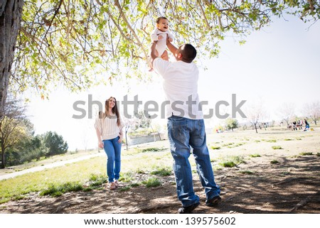 Cherry Blossoms surround a Beautiful young family in Spring time - stock photo