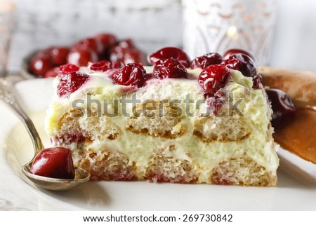 Cherry cake with lady finger biscuits - stock photo
